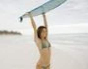 Comment prendre nageoires une planche de surf фото